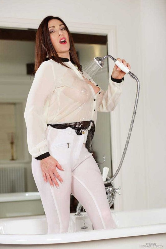 Miss Hybrid tight jodhpurs and see through blouse.