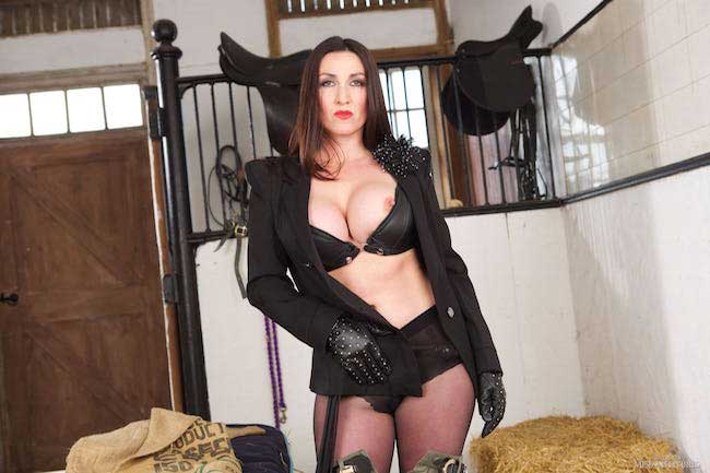 Knee high boots and jodhpurs Miss Hybrid busty equestrian mistress.