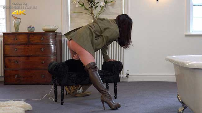 Tight jodhpurs fetish Miss Hybrid leather thigh boots riding her magic wand.